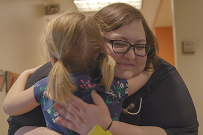 Pediatrics patient hugs nurse