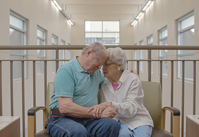Older couple embraces