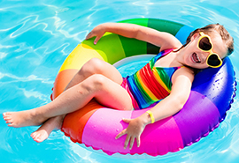 Girl on floaty in pool