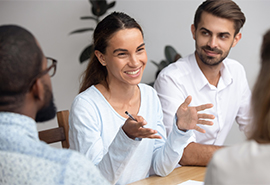Woman talking in group discussion