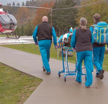 Paramedics take patient helicopter