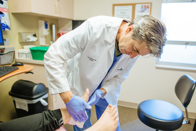 Dr. David examines foot and ankle